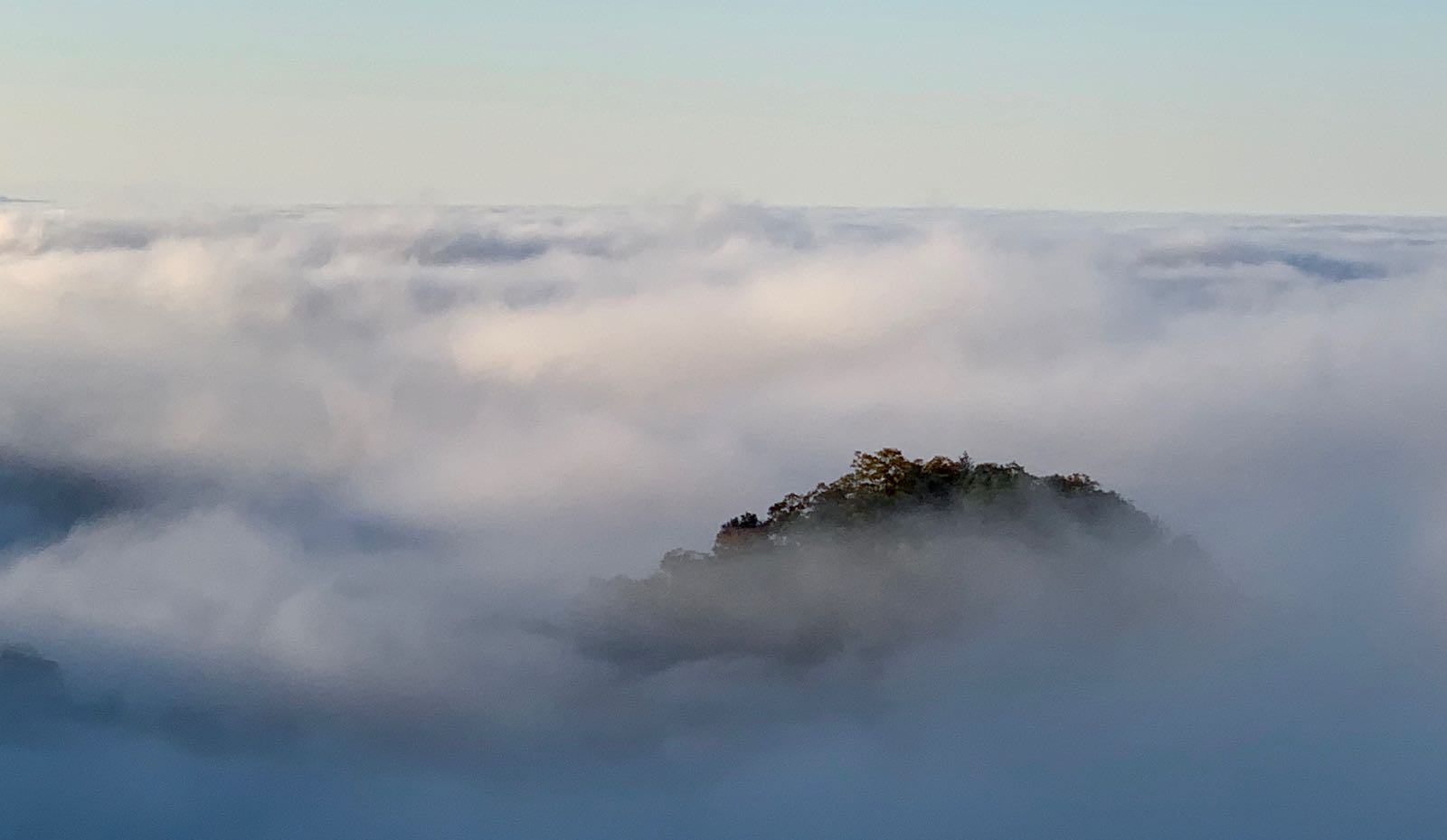 An island disappeared into a sea of clouds, then reemerged minutes later.