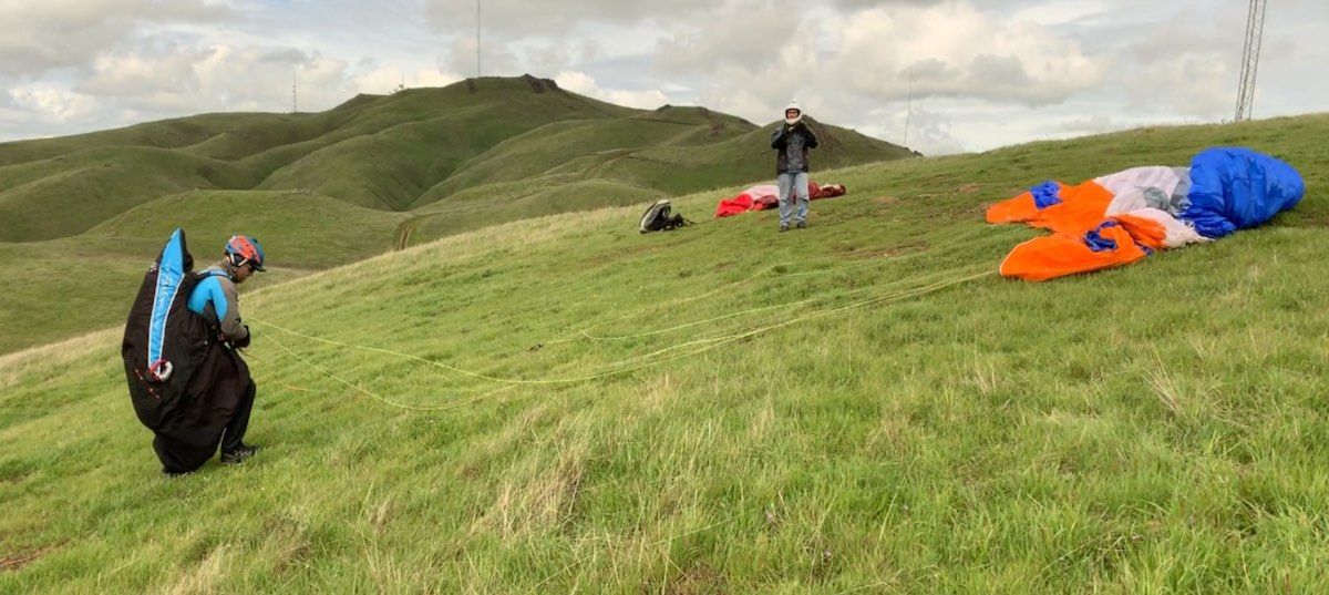 Paragliders checking equipment