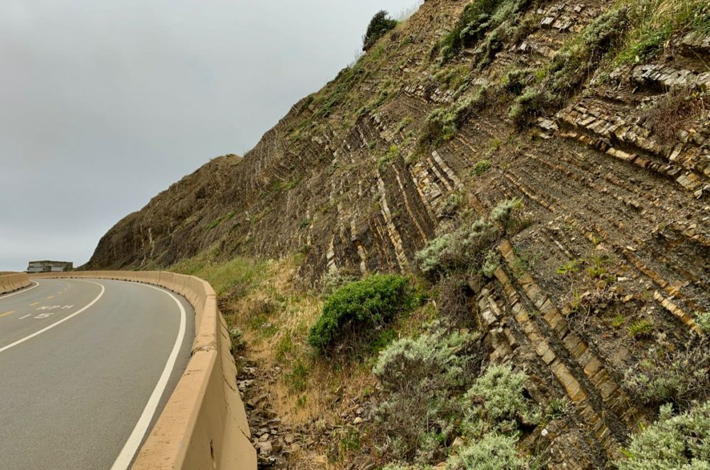 Slanted layers of shale beside the highway