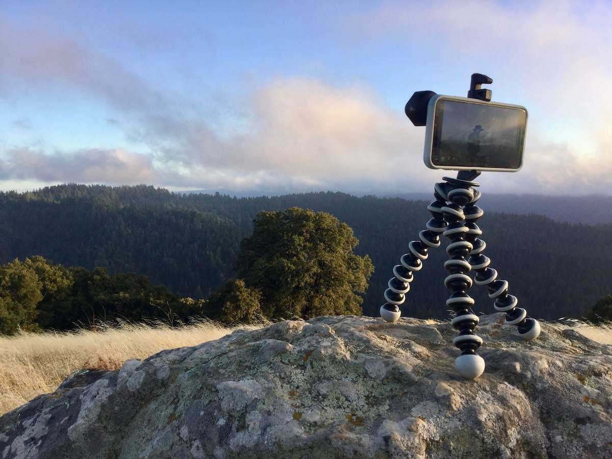 iPhone taking a time-lapse photo for sky and forest