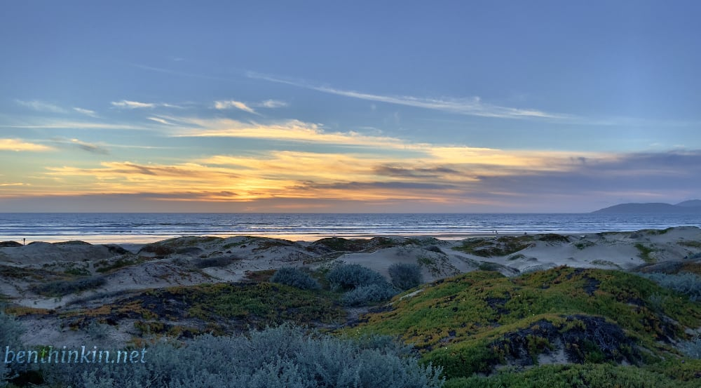 Sunset over sand dunes at Pismo Beach.